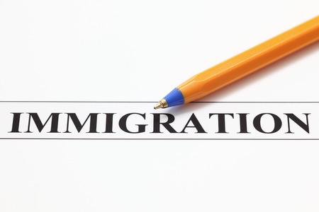 ballpoint pen: Ballpoint pen and word Immigration.