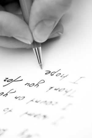writing a letter: Writing letter to a friend.