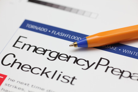 Emergency Checklist and ballpoint pen. Close-up.