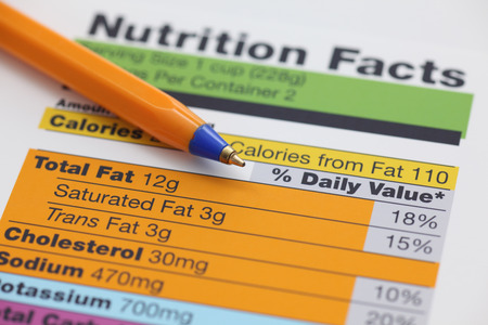 food label: Nutrition facts and ballpoint pen. Close-up.