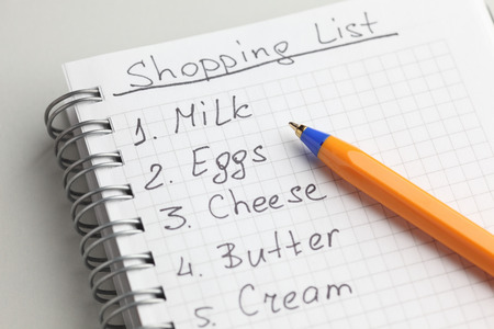 Handwritten shopping list with ballpoint pen.