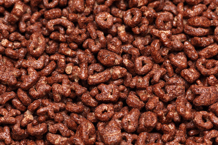 chocolate cereal: Chocolate cereal background. Stock Photo