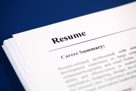 resumes: Stack of resumes on a blue . Stock Photo