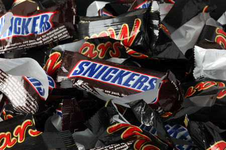 wrappers: Tambov, Russian Federation - September 02, 2012 Empty sweet wrappers of Snickers and Mars minis candy bars heap. Full Frame. Studio shot. Snickers and Mars bars manufactured by Mars, Incorporated. Editorial