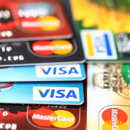 two companies: Tambov, Russian Federation - September 11, 2012 Visa and Mastercard logos on credit cards. Studio shot. Visa and Mastercard are a two biggest credit card companies in the world. Editorial