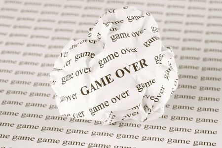 the game is over: Crumpled paper ball with words Game Over