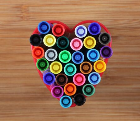 washable: Washable markers in a heart bowl. Close-up.