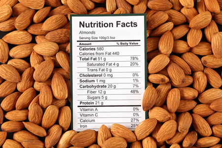 healthy nutrition: Nutrition facts of almonds with almonds  Stock Photo