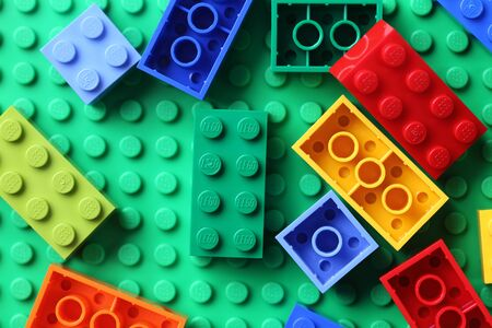 Tambov, Russian Federation - June 22, 2012  LEGO Blocks on a green baseplate. Lego (trademarked in capitals as LEGO) is a popular line of construction toys manufactured by the Lego Group, a privately held company based in Billund, Denmark.