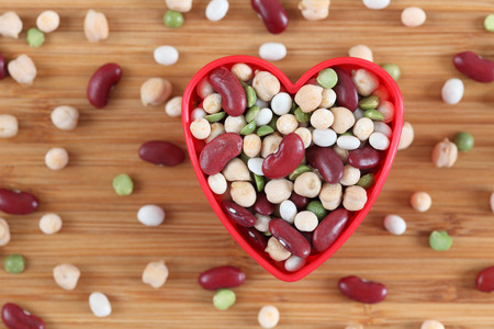 lima bean: Mixed legume beans in a heart bowl. Close-up.