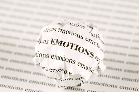 emotion: Crumpled paper ball with words emotions Stock Photo