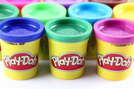 playdoh: Tambov, Russian Federation - Jule 28, 2012 Containers of various colored Play-Doh modeling compound. Play-Doh is manufactured by Hasbro.