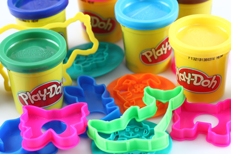jule: Tambov, Russian Federation - Jule 28, 2012 Containers of various colored Play-Doh modeling compound with molds. Play-Doh is manufactured by Hasbro.