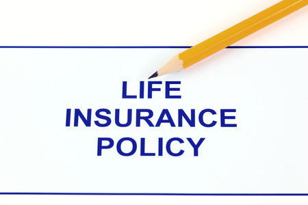 life insurance: Life insurance policy with pencil.