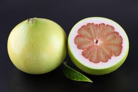 pummelo: Organic pummelo on black  Stock Photo