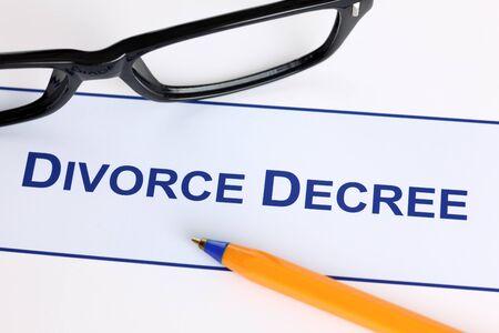 decree: Divorce Decree with black glasses and ballpoint pen. Stock Photo
