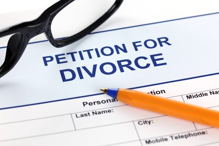 petition: Petition for Divorce with glasses and ballpoint pen.