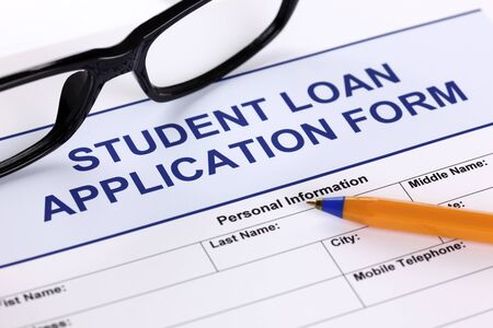 Student Loan Application form with glasses and ballpoint pen
