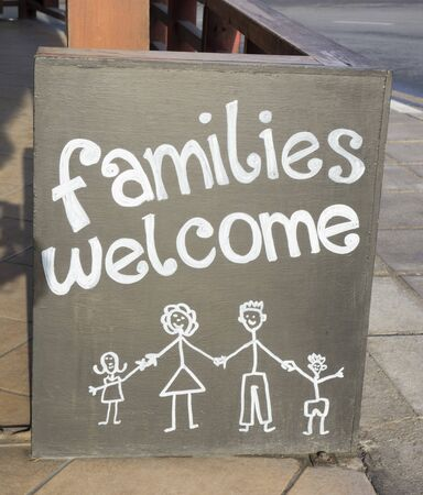 «Families welcome» sign in the street. Stock Photo