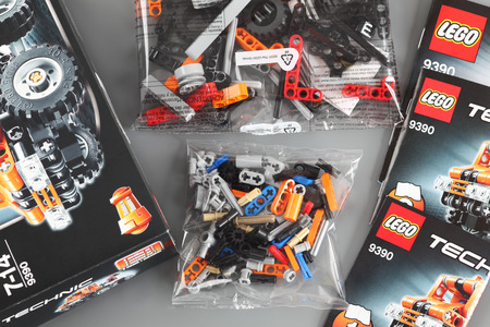 technic: Tambov, Russian Federation - April 06, 2013 LEGO Technic set with box, instructions and details in plastic packs on grey background. Item 9390. Studio shot. Technic is a line of Lego interconnecting plastic rods and parts. Technic sets are often character