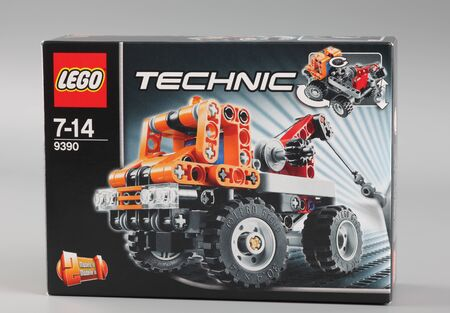 technic: Tambov, Russian Federation - April 07, 2013 LEGO Technic box on grey background. Item 9390. Studio shot. Technic is a line of Lego interconnecting plastic rods and parts. Technic sets are often characterized by the presence of special pieces, such as gear