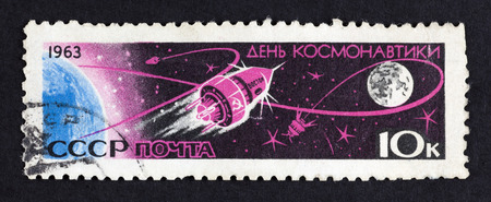 stamp collecting: USSR postage stamp Cosmonauts Day - Vostok 1- Earth and the Moon. 1963 year. Black background. Cosmonauts Day in Russia is on April 12th. It was on that date in 1961 when Yuri Gagarin became the first man in space. Editorial