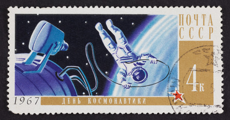 stamp collecting: USSR postage stamp Cosmonauts Day with astronaut in space. 1967 year. Black background. Cosmonauts Day in Russia is on April 12th. It was on that date in 1961 when Yuri Gagarin became the first man in space. Editorial