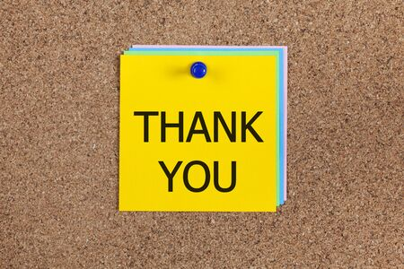 billboard posting: paper notes with word Thank you on corkboard (bulletin board).