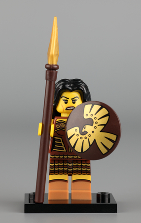 warrior woman: Tambov, Russian Federation - June 02, 2013 Lego Warrior Woman minifigure with lance and shield on gray background. Studio shot. LEGO is a popular line of construction toys manufactured by the Lego Group (Billund, Denmark). Editorial