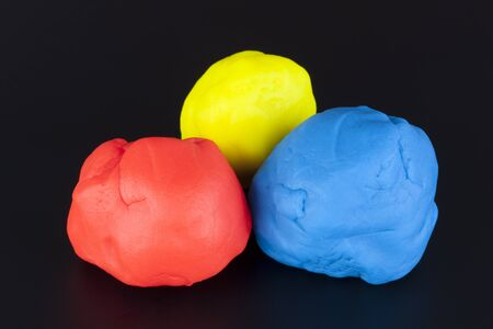 child's play clay: Colorful childs play clay (Red, Yellow, Blue) on black background.