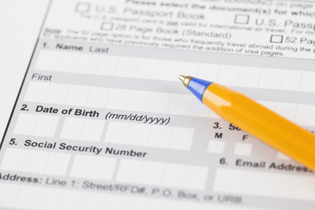 Application form with ballpoint pen. Focus on date of birth.