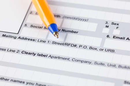 mailing: Application form with ballpoint pen. Focus on mailing address line. Stock Photo