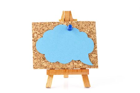 corkboard: Wooden easel with corkboard and blue speech bubble isolated on white background