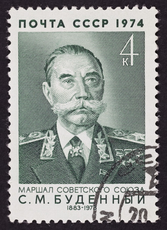 an ally: USSR postage stamp Semyon Budyonny. 1974 year. Black background. Semyon Mikhailovich Budyonny was a Marshal of the Soviet Union, Soviet cavalryman, military commander, politician and a close ally of Soviet leader Iosif Stalin.