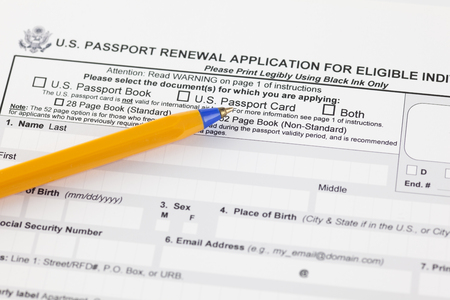 U.S. passport renewal application for eligible individuals with ballpoint pen. Stock Photo
