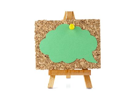 corkboard: Wooden easel with corkboard and green speech bubble isolated on white background