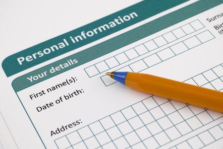 Personal information form with ballpoint pen. Archivio Fotografico