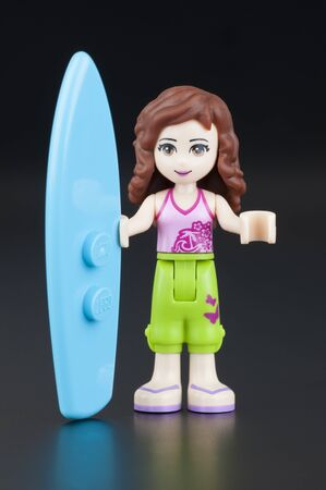 gamme de produit: Tambov, Russian Federation - January 11, 2014 Olivia Lego Friends girl minifigure with surfboard on black background. Studio shot. Lego Friends is a product range of the Lego construction toy designed to appeal primarily to girls.