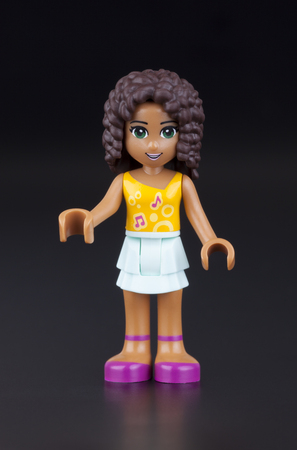 product range: Tambov, Russian Federation - January 11, 2014 Andrea Lego Friends girl minifigure on black background. Studio shot. Lego Friends is a product range of the Lego construction toy designed to appeal primarily to girls. Editorial