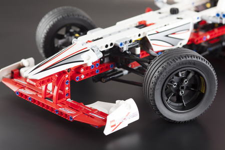 technic: Tambov, Russian Federation - January 12, 2013 LEGO Technic. The front part of Grand Prix Racer model on black background. Item 42000. Ages 11-16. Studio shot. LEGO Technic is a line of Lego interconnecting plastic rods and parts. Technic sets are often ch