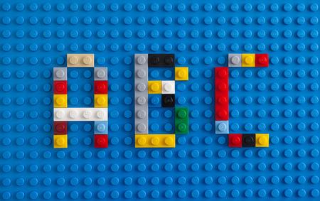 Tambov, Russian Federation - February 20, 2015 Lego custom letter A, B, C on Lego blue baseplate background. Studio shot. Editorial