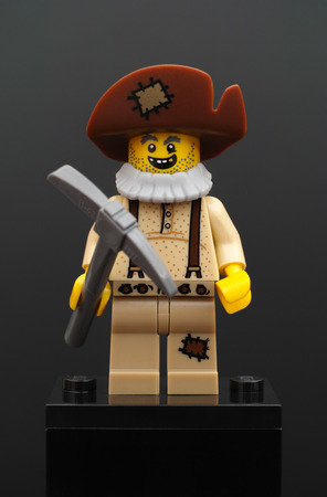 prospector: Tambov, Russian Federation - February 05, 2015 Lego Prospector minifigure with pickaxe on black background. Studio shot.