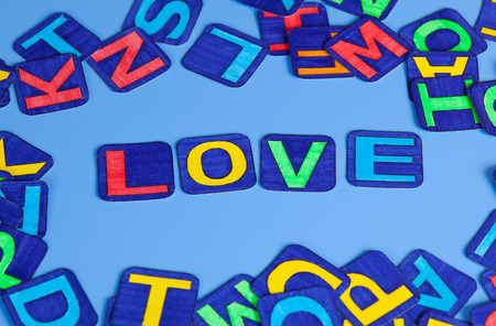 spell: Word Love spell out on blue background. Letters drawn by me.