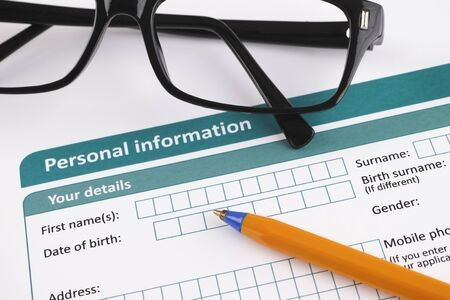 ballpoint pen: Personal information form with ballpoint pen and glasses.