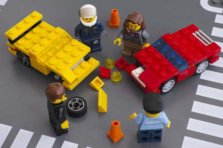 custom car: Tambov, Russian Federation - March 15, 2015 Lego car accident scene. Two custom cars crashed on the road with drivers and police officers minifigures. Car made by my 5 years son. Studio shot.
