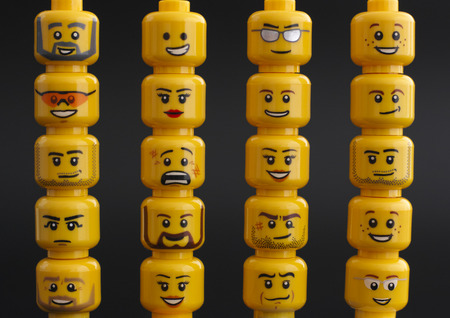 Tambov, Russian Federation - March 24, 2015 Lego figure heads on black background. Studio shot.