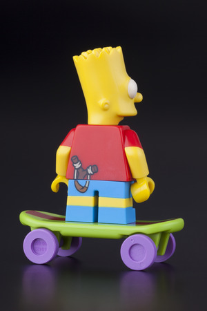 simpson: Tambov, Russian Federation - April 30, 2014 Lego Bart Simpson minifigure back view on skateboard on black background. Studio shot. Editorial