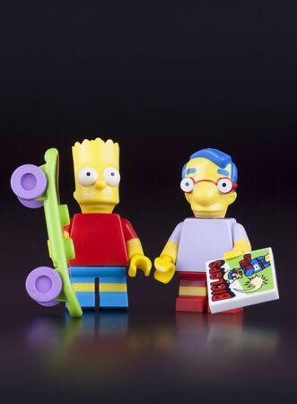 best friend: Tambov, Russian Federation - April 30, 2014 Lego Bart Simpson and his best friend Milhouse Mussolini Van Houten minifigures on black background. Studio shot.