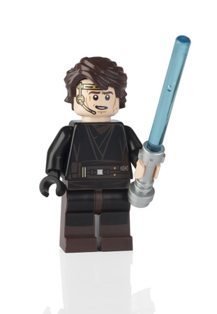 Tambov, Russian Federation - June 21, 2014 LEGO Anakin Skywalker minifigure from Star Wars set with Lightsaber on white background. Studio shot. Lego Star Wars is a Lego theme that incorporates the Star Wars saga.