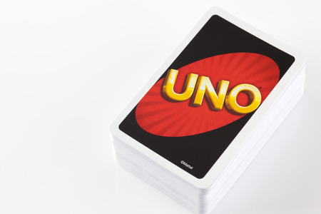 Tambov, Russian Federation - August 24, 2013 Deck of UNO game cards on white background. Studio shot. Uno is an American card game which is played with a specially printed deck. The deck consists of 108 cards. The game has been a Mattel product since 1992 Editorial